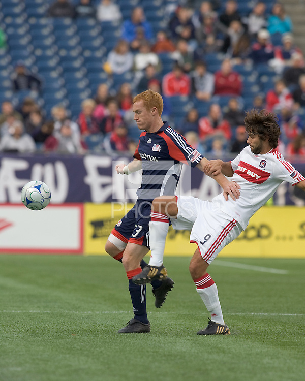 New England Revolution midfielder/defender Jeff Larentowicz (13) controls the ball as Chicago Fire midfielder Baggio Husidic (9) defends. The New England Revolution out scored the Chicago Fire, 2-1, in Game 1 of the Eastern Conference Semifinal Series at Gillette Stadium on November 1, 2009.