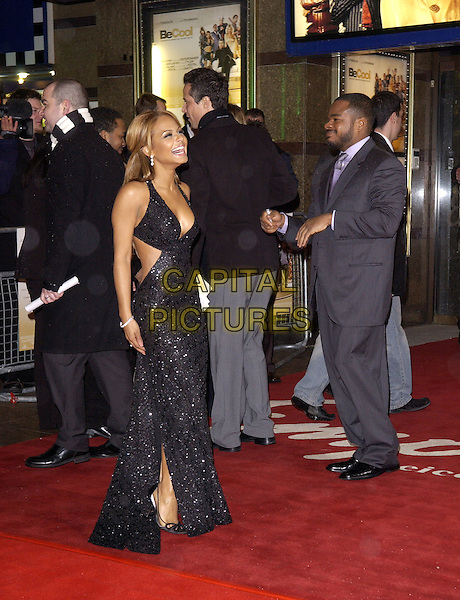 "CHRISTINA MILIAN.""Be Cool"" Premiere Leicester Square, London, WC2.March 7th, 2005.full length black halterneck sequined dress laughing.www.capitalpictures.com.sales@capitalpictures.com.© Capital Pictures."