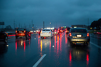 Morning commuters drive the Mopac Expressway (Loop 1) to downtown Austin during rush hour rain storm in north Austin, Texas.