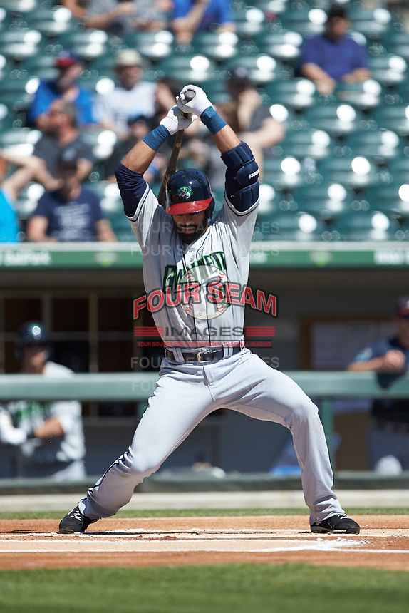 Jose Bautista (19) of the Gwinnett Stripers gets out of the way of an inside pitch against the Charlotte Knights at BB&T BallPark on May 2, 2018 in Charlotte, North Carolina.  The Knights defeated the Stripers 6-5.  (Brian Westerholt/Four Seam Images)