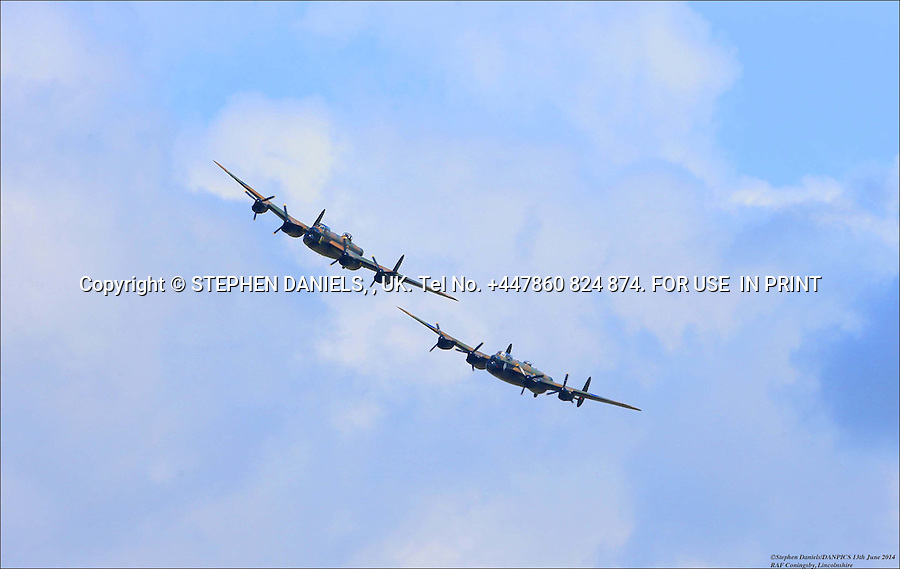 Two Lancaster fly again<br />  *NO INTERNET USE PERMITTED*  PRINT MEDIA ONLY<br /> &gt;<br /> DANPIC's; Photo by &copy; Stephen Daniels 13/08/2014 <br /> The Canadian Lancaster joins the RAF Coningsby BBMF Lancaster after 50+ years for the first time. Coningsby, Lincs<br /> <br /> Minimum Fee &pound;200.00+vat<br /> &gt;<br /> All images supplied under the terms and condition of <br /> Stephen Daniels and not publication which use them.<br /> All images which is the copyright of Stephen Daniels<br /> and/or DANPICS are supplied under the terms and <br /> condition of Stephen Daniels<br /> &gt;<br /> Words by Medialincs Tel 07933 676119 Richard Vamplew