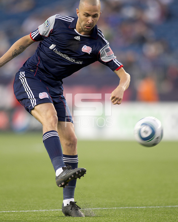 New England Revolution forward Rajko Lekic (10) crosses the ball. In a Major League Soccer (MLS) match, the New England Revolution tied Toronto FC, 0-0, at Gillette Stadium on June 15, 2011.