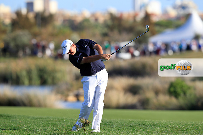 Shane Lowry (IRL) plays his 2nd shot on the 18th hole during Saturday's Round 3 of the Portugal Masters at the Oceanico Victoria Golf Course, Vilamoura, Portugal 13th October 2012 (Photo Eoin Clarke/www.golffile.ie)