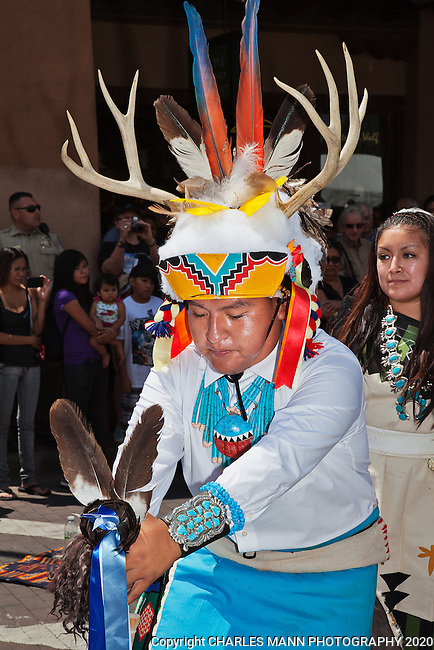 The Santa Fe Indian Market is held in August of each year on the Santa Fe Plaza and is the largest Native American Art event in the country. The 2012 Indian Market filled  the plaza with shoppers, tourists, dancers and artists. A dancerfrom Zuni Pueblo leads a troupe performing on teh palza during the 2012 Santa Fe Indian Market.