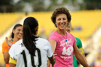 Michelle Akers shakes hands with Marta after the first kick during the Women's Professional Soccer (WPS) All-Star Game at KSU Stadium in Kennesaw, GA, on June 30, 2010.