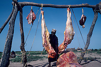 Hanging the animal instead of slaughtering it on the soil to void contamination