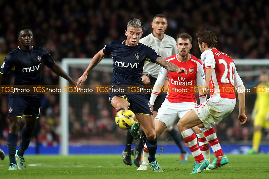 Toby Alderweireld of Southampton takes on the Arsenal defence - Arsenal vs Southampton - Barclays Premier League Football at the Emirates Stadium, London - 03/12/14 - MANDATORY CREDIT: Paul Dennis/TGSPHOTO - Self billing applies where appropriate - contact@tgsphoto.co.uk - NO UNPAID USE