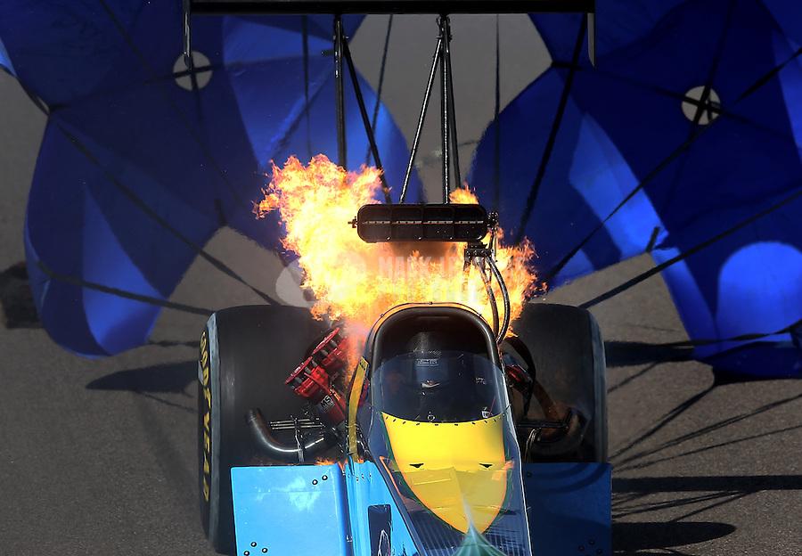 Feb. 23, 2013; Chandler, AZ, USA; NHRA top fuel dragster driver Sidnei Frigo blows an engine on fire during qualifying for the Arizona Nationals at Firebird International Raceway. Mandatory Credit: Mark J. Rebilas-
