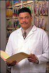 portrait of doctor in lab coat holding medical records