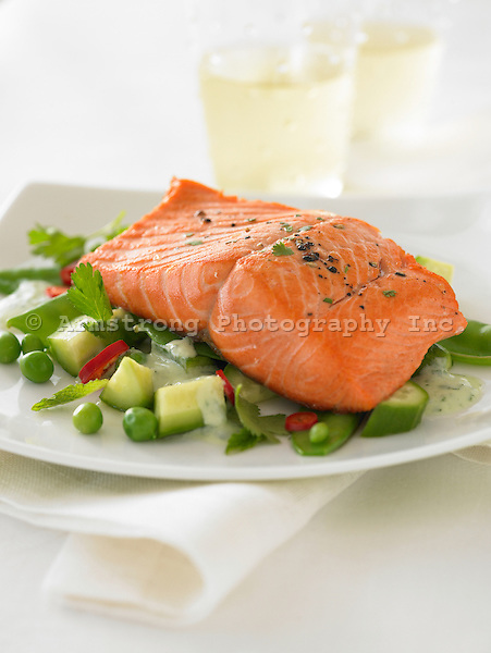 Sockeye salmon fillet with fresh vegetables and yogurt sauce