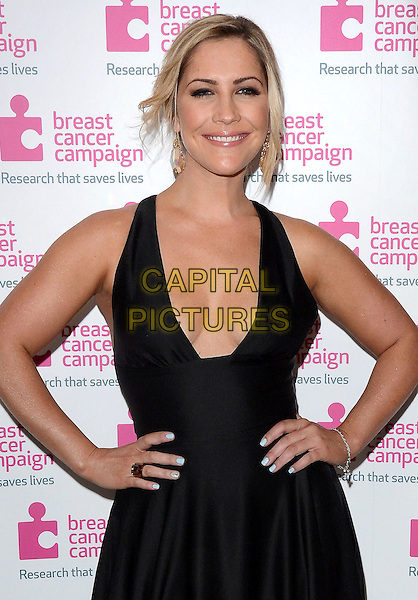 Heidi Range of Sugababes <br /> attending the Pink Ribbon Ball in aid of Breast Cancer Campaign - at the Dorchester Hotel, Park Lane, London, England.<br /> October 12th 2013.<br /> half length black dress plunging neckline cleavage hands on hips <br /> CAP/PP/MB<br /> &copy;Michael Ball/PP/Capital Pictures