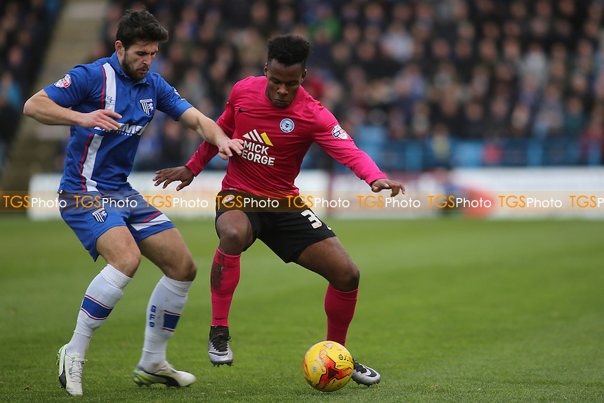 Peterborough's Shaquile Coulthirst shields the ball from Gillingham's Aaron Morris during Gillingham vs Peterborough United, Sky Bet League 1 Football at the MEMS Priestfield Stadium, Gillingham, England on 23/01/2016