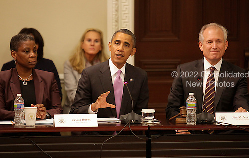 United States President Barack Obama delivers remarks at a meeting of his Export Council in the Eisenhower Executive Office Building in Washington, DC on September 19, 2013. From left to right: Ursula M. Burns, Chairwoman and CEO of Xerox; President Obama; and Jim McNerney, Jr., Chairman of the Board, President and CEO, Boeing Company.<br /> Credit: Yuri Gripas / Pool via CNP