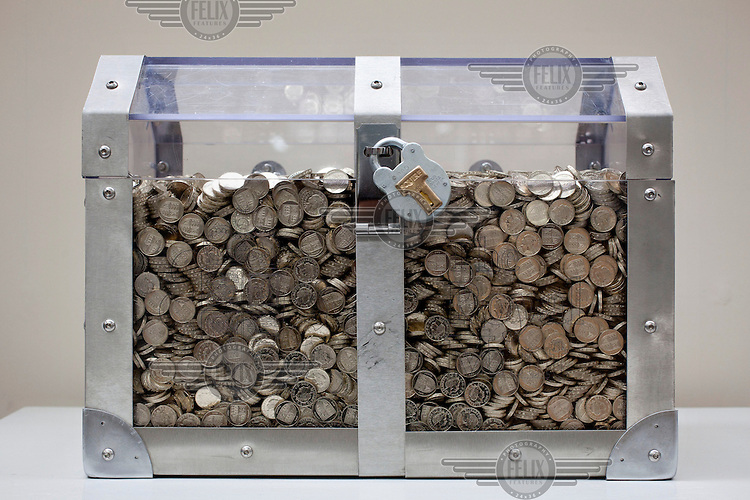 A secure box containing newly minted 1 GBP coins, at the Royal Mint, near Llantrisant in Mid Glamorgan. As well as producing coinage for domestic use the mint also manufactures coins for around 60 countries worldwide.