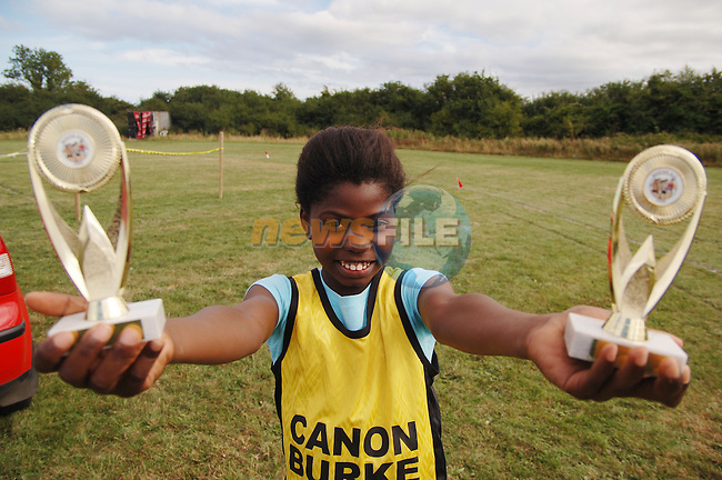 August 13, 2006 - Boyne AC Sports Day held at Drogheda, County Louth. Christiana Adegbamiye shows off her winning trophies from the above..Photo: BARRY CRONIN/Newsfile..(Photo credit should read BARRY CRONIN/NEWSFILE).