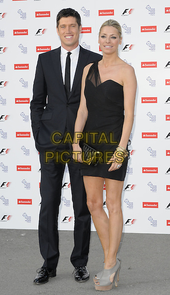 VERNON KAY & TESS DALY .The F1 Party held at the Natural History Museum, London, England, UK..5th July 2010.Formula one full length black sheer one shoulder dress clutch bag wooden wood grey gray wedges platform suit tie white shirt married husband wife peep toe.CAP/CAN.©Can Nguyen/Capital Pictures.