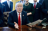 United States President Donald Trump speaks before signing an executive order establishing regulatory reform officers and task forces in US agencies in the Oval Office of the White House on February 24, 2017 in Washington, DC. <br /> Credit: Olivier Douliery / Pool via CNP