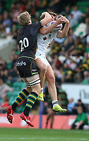 Clermont Auvergne's Damian Penaud catches the ball under pressure from Northampton Saints's Jamie Gibson<br /> <br /> Photographer Stephen White/CameraSport<br /> <br /> European Rugby Challenge Cup - Northampton Saints v Clermont Auvergne - Saturday 13th October 2018 - Franklin's Gardens - Northampton<br /> <br /> World Copyright © 2018 CameraSport. All rights reserved. 43 Linden Ave. Countesthorpe. Leicester. England. LE8 5PG - Tel: +44 (0) 116 277 4147 - admin@camerasport.com - www.camerasport.com