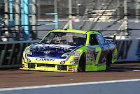 Apr 17, 2009; Avondale, AZ, USA; NASCAR Sprint Cup Series driver Robby Gordon during qualifying for the Subway Fresh Fit 500 at Phoenix International Raceway. Mandatory Credit: Mark J. Rebilas-