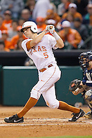 Andy McGuire #5 of the Texas Longhorns follows through on his swing against the Rice Owls at Minute Maid Park on February 28, 2014 in Houston, Texas.  The Longhorns defeated the Owls 2-0.  (Brian Westerholt/Four Seam Images)