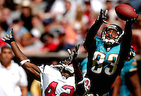 Jacksonville Jaguars receiver #83 J.J. Stokes gets a hand on the football but can't make the catch as Houston texans cornerback #42 Marcus Coleman defends on the play at Jacksonville Municipal Stadium.
