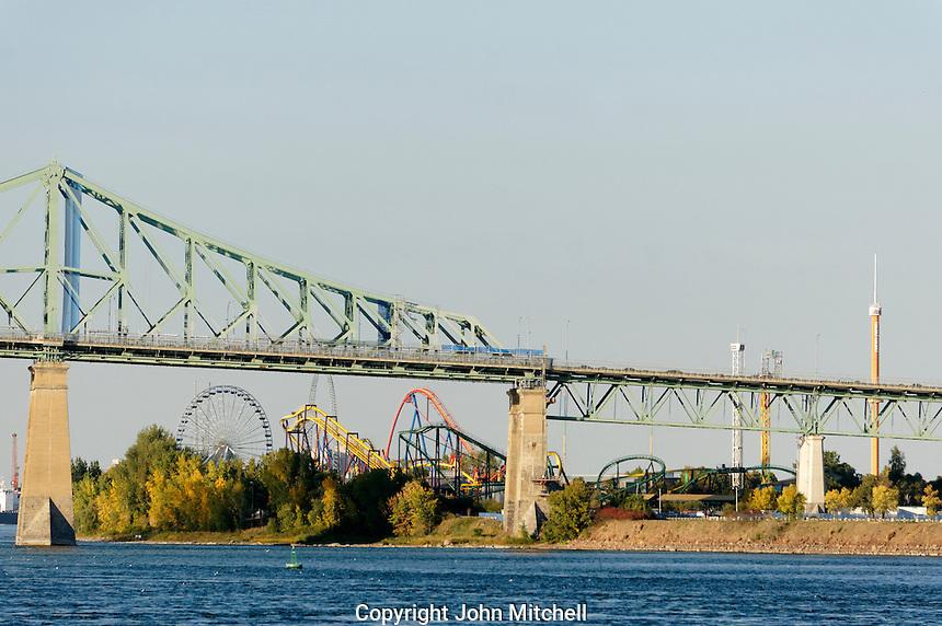 La Ronde amusement park on St. Helen's Island, Pont Jacques Cartier bridge and St. Lawrence River, Montreal, Quebec, Canada