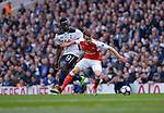 Aaron Ramsey of Arsenal is challenged by Victor Wanyama of Tottenham Hotspur during the English Premier League match at the White Hart Lane Stadium, London. Picture date: April 30th, 2017.Pic credit should read: Robin Parker/Sportimage
