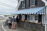People gather around the order window at The Galley, a long-standing restaurant and snack shop in Chilmark/Menemsha, Martha's Vineyard, Massachusetts, USA.