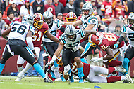 Landover, MD - October 14, 2018: Carolina Panthers wide receiver DJ Moore (12) fumbles the ball during the  game between Carolina Panthers and Washington Redskins at FedEx Field in Landover, MD.   (Photo by Elliott Brown/Media Images International)