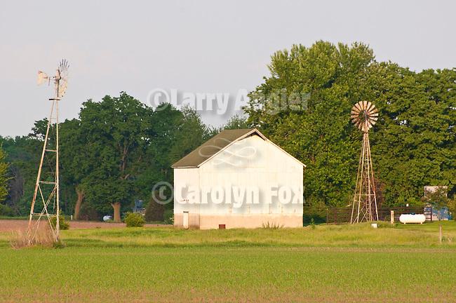 White barn, metal windmills, rural Ill.
