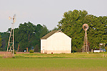 White barn, metal windmills, rural Ill.