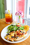 Two Loons Cafe, a sandwich shop located in Old Town Bandon, Oregon. Grilled bruschetta with a green salad and iced tea.