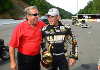 Jun. 17, 2012; Bristol, TN, USA: NHRA top fuel dragster driver Tony Schumacher (right) is congratulated by team owner and father Don Schumacher  after winning the Thunder Valley Nationals at Bristol Dragway. Mandatory Credit: Mark J. Rebilas-