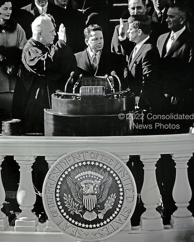 United States President John F. Kennedy is sworn-in as the 35th President of the United States by Chief Justice of the United States Earl Warren, left, on the East Front of the U.S. Capitol in Washington, D.C. on Friday, January 20, 1961..Credit: Arnie Sachs / CNP