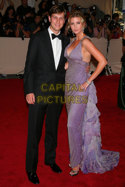"""JARED KUSHNER & IVANKA TRUMP .attending the Metropolitan Museum of Art's Costume Institute Gala """"American Woman: Fashioning A National Identity"""" held at the Metropolitan Museum of Art, New York, NY, USA, May 3rd, 2010..arrivals full length purple sleeveless long maxi dress silver sparkly ruffles ruffle straps open toe shoes sandals hand on hip husband wife couple married black bow tie tuxedo tux . CAP/LNC/TOM.©LNC/Capital Pictures."""