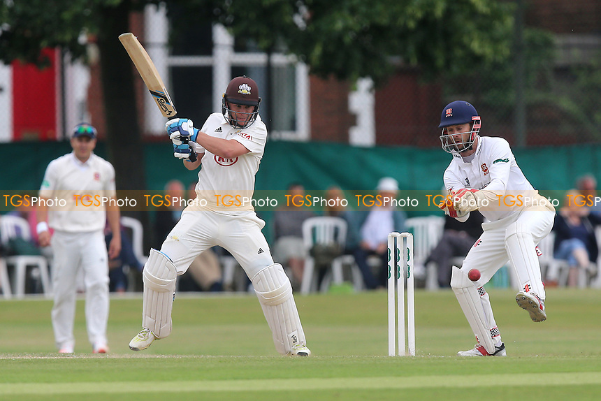Scott Borthwick in batting action for Surrey as James Foster looks on from behind the stumps during Surrey CCC vs Essex CCC, Specsavers County Championship Division 1 Cricket at Guildford CC, The Sports Ground on 11th June 2017