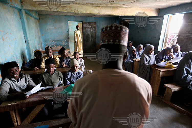 Muslim students attend an Islamic school in a muslim dominated area in Jos. In recent years attacks have become more frequent between the Christians and Muslim communities in Jos with hundreds dying in attacks and bombings.
