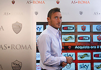 Il capitano della Roma Francesco Totti arriva alla conferenza stampa in occasione del rinnovo del suo contratto al centro sportivo Fulvio Bernardini di Trigoria, Roma, 20 settembre 2013.<br /> AS Roma football team's captain Francesco Totti arrives for the press conference in occasion of the renewal of his contract at the club's sporting center in Rome, 20 September 2013.<br /> UPDATE IMAGES PRESS/Isabella Bonotto
