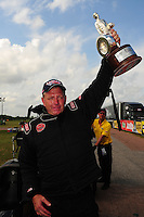 Apr. 29, 2012; Baytown, TX, USA: NHRA top alcohol dragster driver Jim Whiteley celebrates after winning the Spring Nationals at Royal Purple Raceway. Mandatory Credit: Mark J. Rebilas-