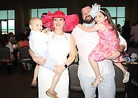 NWA Democrat-Gazette/CARIN SCHOPPMEYER Emily and Brian Avra hold their children Beckett and Austyn at A Nite at the Races on May 6 at Fayetteville Town Center.