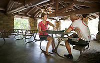 NWA Democrat-Gazette/DAVID GOTTSCHALK Crystal (left) and Don Day, of Lincoln Neb., eat lunch Monday, June 11, 2018, on the outdoor dining area of the Ridge Runner Cafe and Store at Devil's Den State Park. A portion of the building was destroyed by a fire in 2015 but reopened this March. The building and park was built by the Civilian Conservation Corps in the 1930's.