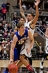 OMAHA, NE - January 10, 2015 -- Marcus Tyus (23) of UNO defends South Dakota State's Keaton Moffitt (12) during the first half of their game Saturday evening at the Ralston Arena in Ralston, NE. (Photo By Ty Carlson / DakotaPress)