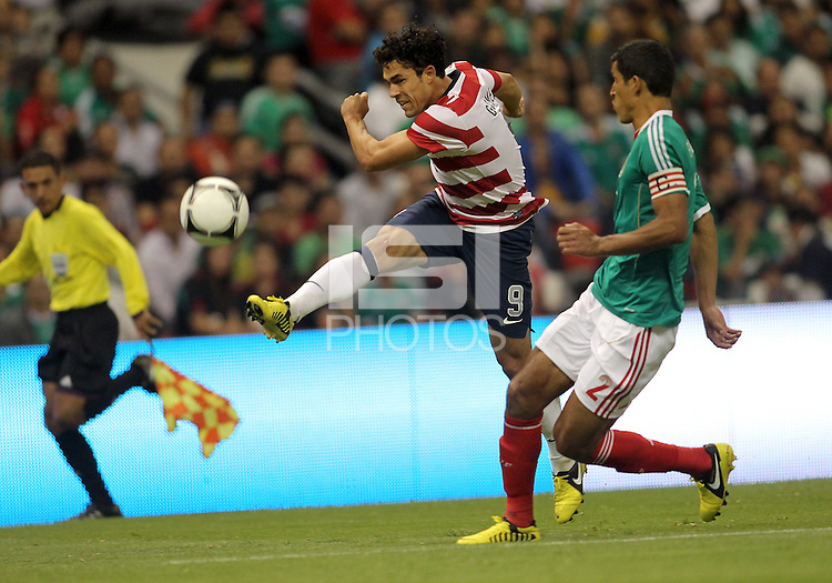 MEXICO CITY, MEXICO - AUGUST 15, 2012:  Herculez Gomez (9) of the USA MNT blasts a shot past Fransisco (Maza) Javier Rodriguez (2) of  Mexico during an international friendly match at Azteca Stadium, in Mexico City, Mexico on August 15. USA won 1-0.