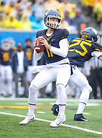 Morgantown, WV - November 18, 2017: West Virginia Mountaineers quarterback Chris Chugunov (11) attempts a pass during game between Texas and WVU at  Mountaineer Field at Milan Puskar Stadium in Morgantown, WV.  (Photo by Elliott Brown/Media Images International)