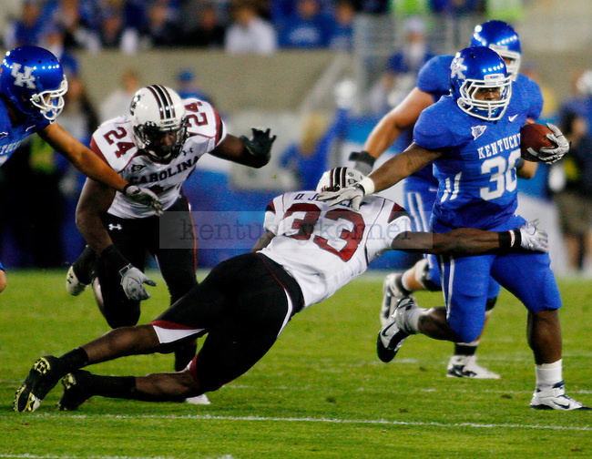 Moncell Allen plows past Gamecock defense in the second half of UK's 31-28 win over  South Carolina football on Saturday, Oct. 16, 2010. Photo by Britney McIntosh | Staff