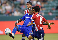 Kansas City Wizards midfielder Kei Kamara double teamed and scores. The Kansas City Wizards defeated CD Chivas USA 2-0 at Home Depot Center stadium in Carson, California on Sunday September 19, 2010.