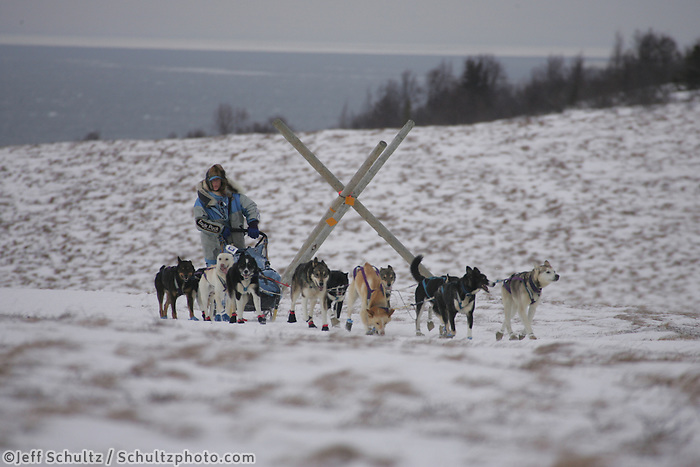 Dee Dee Jonrowe on the trail between Unalakleet and Shaktoolik near Egavik,  2005 Iditarod Trail Sled Dog Race.
