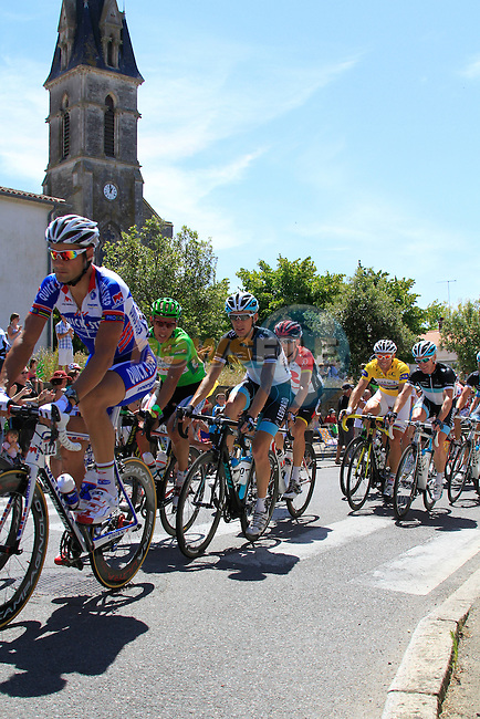 The pelethon including Quick Step's Tom Boonen (BEL), Omega Pharma-Lotto's Philippe Gilbert Green Jersey chatting to Leopard Trek's Andy Schleck (LUX) and Garmin-Cervelo's Thor Hushovd (NOR) Yellow Jersey chatting to Leopard Trek's Stuart O'Grady (AUS) pass through the town of Vaire during the 3rd Stage of the 2011 Tour de France, 198k from Olonne-sur-Mere to Redon, 4th July 2011 (Photo by Eoin Clarke/NEWSFILE)