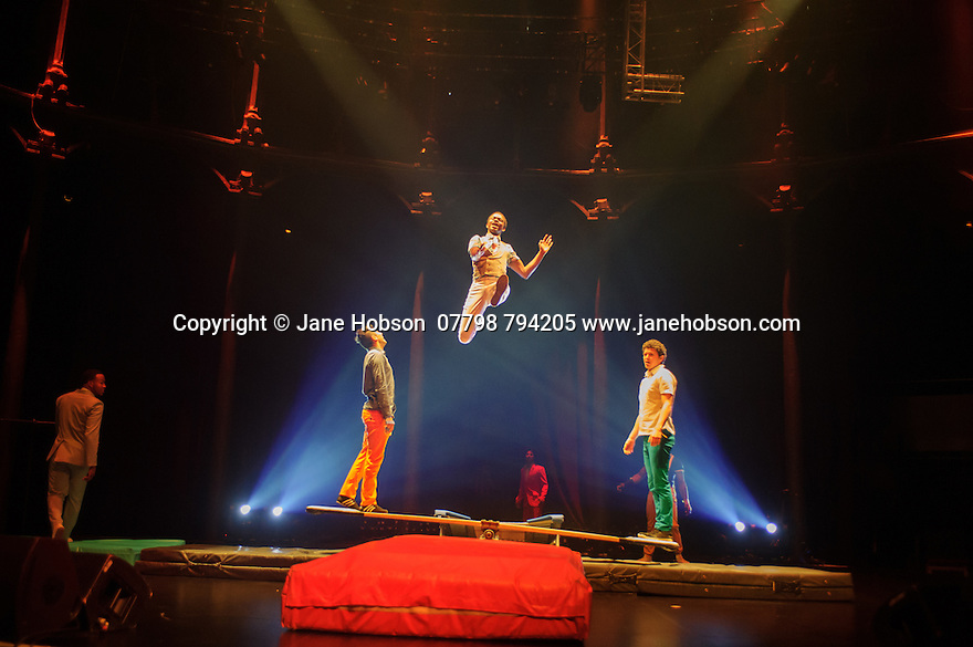 "London, UK. 14.04.2015. Circolombia presents ""Acelere"" at the Roundhouse. Picture shows: Juan Eugenio Bonilla Landazuri, Gustavo Adolfo Quinones Castro, Jhon Edward Angulo Ibarguen, Jhon Gerlin Rodriguez Riascos, Daniel Munoz, Juan Manuel Navarro Rubiano, Juan Camilo Gaitan Lopez using the teeterboard and tumbling. Photograph © Jane Hobson."