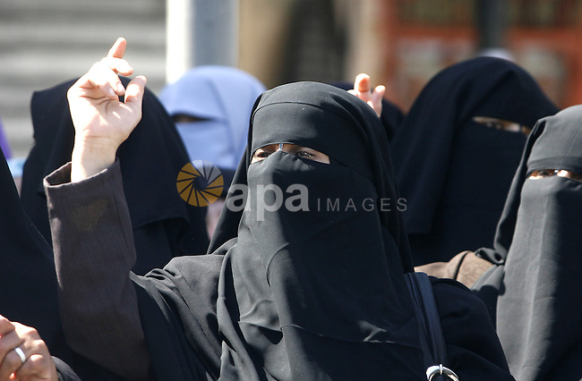 Palestinian women shout anti-US slogans during a demonstration against the controversial film 'Innocence of Muslims' in Rafah southern Gaza strip, on September 14, 2012. The controversial low budget film reportedly made by an Israeli-American which portrays Muslims as immoral and gratuitous, sparked fury in Libya, where four Americans including the ambassador were killed on Tuesday when a mob attacked the US consulate in Benghazi, and has led to protests outside US missions in Morocco, Sudan, Egypt, Tunisia and Yemen. Photo by Eyad Al Baba
